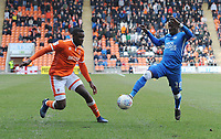 Blackpool's Donervon Daniels vies for possession with Peterborough United's Siriki Dembele<br /> <br /> Photographer Kevin Barnes/CameraSport<br /> <br /> The EFL Sky Bet League One - Blackpool v Peterborough United - Saturday 13th April 2019 - Bloomfield Road - Blackpool<br /> <br /> World Copyright &copy; 2019 CameraSport. All rights reserved. 43 Linden Ave. Countesthorpe. Leicester. England. LE8 5PG - Tel: +44 (0) 116 277 4147 - admin@camerasport.com - www.camerasport.com