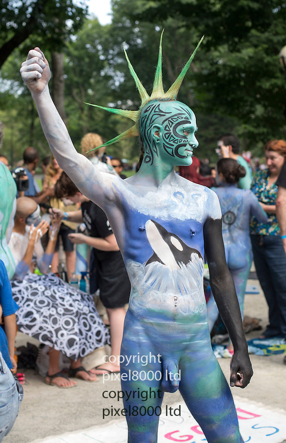 Pic shows: Nude body painting rally with ore than 50 nudist models getting painted by 40 body painting artists in the first ever New York City body painting day.<br /> Near Central Park.<br /> <br /> People were queuing up to take part in the event as models and they came in all shapes, sizes, old and young<br /> <br /> Perhaps unsurprisingly the event attacked even more spectators - particularly keen amateur photographers no doubt keen to improve their portfolio.<br /> <br /> <br /> <br /> <br /> <br /> Pic by Gavin Rodgers/Pixel 8000 Ltd