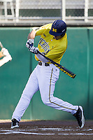Michigan Wolverines outfielder Jackson Glines (27) swings the bat during the NCAA season opening baseball game against the Texas State Bobcats on February 14, 2014 at Bobcat Ballpark in San Marcos, Texas. Texas State defeated Michigan 8-7 in 10 innings. (Andrew Woolley/Four Seam Images)