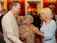 12 July 2016 - London, England - Camilla, Duchess of Cornwall, shares a joke with Richard E Grant and Miriam Margolyes as she hosts the 30th Anniversary Garden Party for the National Osteoporosis Society in St James Palace in London. Due to inclement weather the event was moved indoors. The Duchess of Cornwall has been connected with the charity for nearly 30 years. Photo Credit: ALPR/AdMedia
