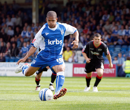 5th September 2009. Gillingham's Simeon Jackson hits his side's opening goal from the penalty spot. Division 1 match - Gillingham v Exeter City at Priestfield Stadium, Gillingham, Kent, England.Photo: Colin Read/Actionplus.