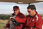 "Former Washington State head baseball coach and Cougar Legend, Chuck ""Bobo"" Brayton, rides out with current WSU head baseball coach, Donnie Marbut, to shoot off the shotgun to start the golf tournament during the 2010 Cougar Baseball Alumni Weekend at Palouse Ridge on the WSU campus in Pullman, Washington, on September 10-11, 2010."