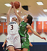 Kelly Trotta #3 of Manhasset, left, and Emily Gonzalez #11 of Farmingdale battle for control of a rebound during a non-league girls basketball game at Manhasset High School on Saturday, Dec. 8, 2018. Manhasset won by a score of 50-33.