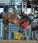 Curtis Garton competes in the saddle bronc event at the Reno Rodeo, in Reno, Nev. on Friday night, June 22, 2012..Photo by Cathleen Allison