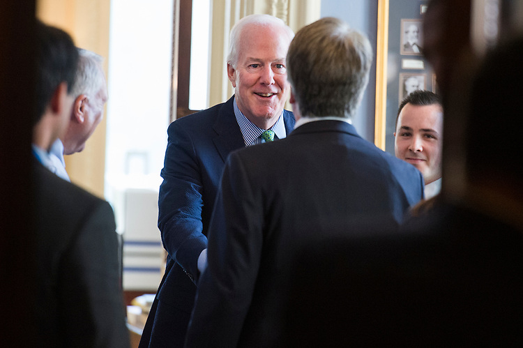 UNITED STATES - JULY 11: Sen. John Cornyn, R-Texas, left, greets Supreme Court nominee Brett Kavanaugh, before a meeting in the Capitol on July 11, 2018. (Photo By Tom Williams/CQ Roll Call)