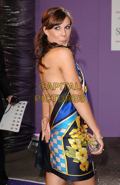 VERITY RUSHWORTH.Arrivals at the British Soap Awards 2007, BBC Television Centre, London, England. .May 26, 2007.half length black blue gold print silk halterneck dress backless looking over shoulder silver clutch purse.CAP/BEL.©Belcher/Capital Pictures