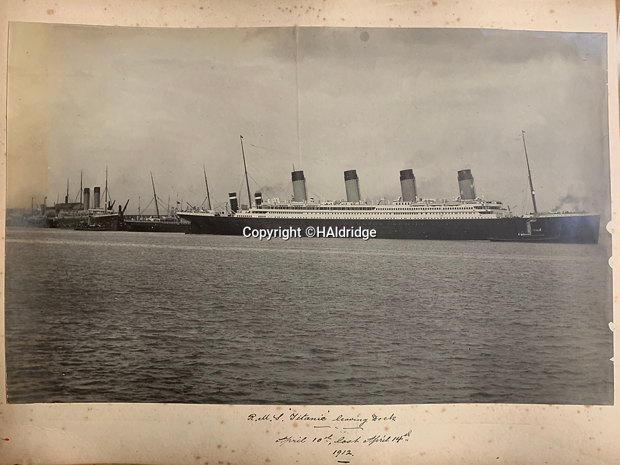 BNPS.co.uk (01202 558833)<br /> Pic: HAldridge/BNPS<br /> <br /> PICTURED: Another image of Titanic (right) shows it leaving the quayside in Southampton. In the background are the liners Oceanic and New York which both had a near miss with Titanic. <br /> <br /> An incredibly rare photograph that was taken on board the Titanic while the liner was on he doomed maiden voyage has surfaced.The poignant image was taken by a first class passenger who was stood on the boat deck as Titanic crossed the Solent about an hour after slipping its mooring.Father Francis Browne leant over the railing to capture the pilot boat leaving Titanic for the last time having picked up harbour pilot George Bowyer.Mr Bowyer had just manoeuvred the 46,000 tonne ship out of congested Southampton Water and into the Solent on April 10, 1912.