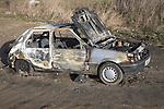 Burned out abandoned car Suffolk, England, UK