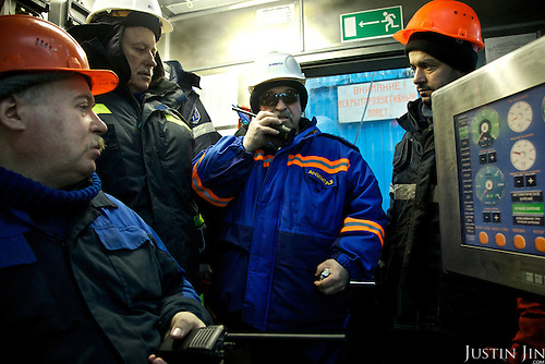 Achimgaz manager Varvaz talks on his walkie at a gas drilling well in Novy Urengoi, Siberia, Russia.
