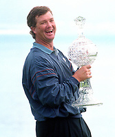 Peter Jacobson holding trophy after winning the 1995<br />