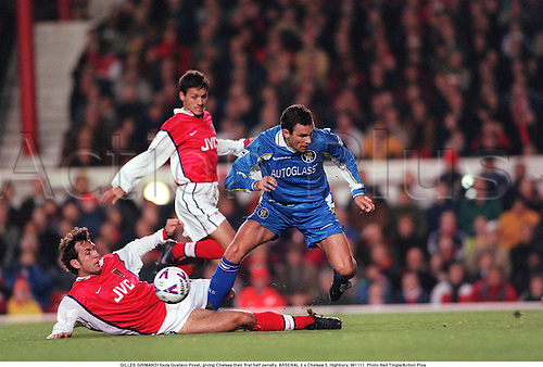 GILLES GRIMANDI fouls Gustavo Poyet, giving Chelsea their first half penalty. ARSENAL 0 v Chelsea 5, Highbury, 981111. Photo:Neil Tingle/Action Plus...1998.Slide-tackle.Aggression.Soccer.football.foul fouls fouling fouled.premiership premier league.club clubs.tackle tackles tackling tackled