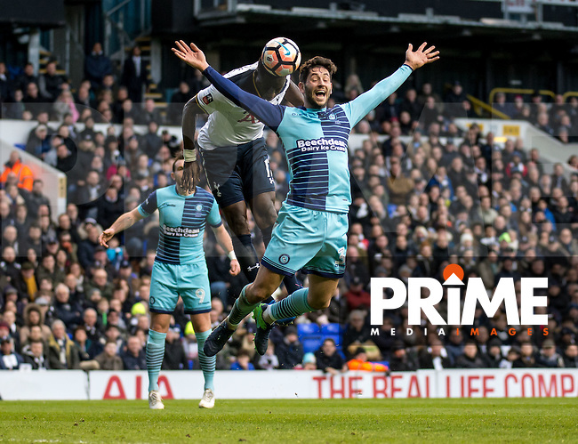 Moussa Sissoko of Tottenham Hotspur heads towards goal with Joe Jacobson of Wycombe Wanderers during the FA Cup 4th round match between Tottenham Hotspur and Wycombe Wanderers at White Hart Lane, London, England on the 28th January 2017. Photo by Liam McAvoy.