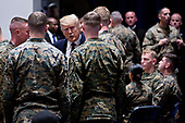 United States President Donald J. Trump, center left, greets Marines while visiting Marine Barracks in Washington, D.C., U.S, on Thursday, Nov. 15, 2018. President Trump and the First Lady are meeting with Marines who responded to a building fire at the Arthur Capper Public Housing complex on September 9, 2018. <br /> Credit: Andrew Harrer / Pool via CNP
