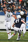 Hawaii quarterback Max Wittek (13) throws downfield against Nevada defenders Matthew Lyons (9) and Jordan Dobrich (49) during the first half of an NCAA college football game in Reno, Nev., on Saturday, Oct. 24, 2015. (AP Photo/Cathleen Allison)