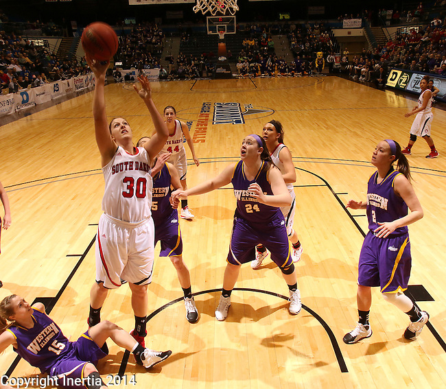 SIOUX FALLS, SD - MARCH 9:  Margaret McCloud #30 from the University of South Dakota shoots past Rebecca Henricson #15, Ashley Luke #5 and Marley Hall #24 from Western Illinois in the second half of their semifinal game at the 2014 Summit League Tournament in Sioux Falls, SD.  (Photo by Dave Eggen/Inertia)