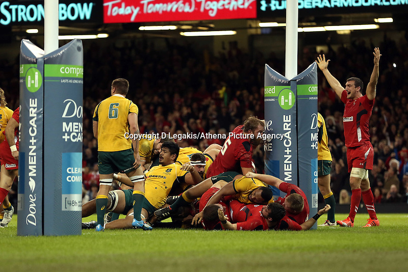 Pictured: Wales captain Sam Warburton (R) is protesting to the referee for not awarding a try. Saturday 08 November 2014<br /> Re: Dove Men Series rugby, Wales v Australia at the Millennium Stadium, Cardiff, south Wales, UK.