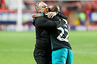 (L-R) Swansea City manager Steve Cooper celebrates his team's win with Andre Ayew during the Sky Bet Championship match between Charlton Athletic and Swansea City at The Valley, London, England, UK. Wednesday 02 October 2019