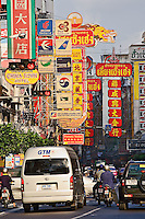 Signs and traffic congestion, Chinatown, Bangkok, Thailand