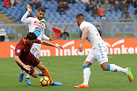 Roma&rsquo;s Diego Perotti, left, is chased by Napoli&rsquo;s Lorenzo Insigne, center, and Faouzi Ghoulam during the Italian Serie A football match between Roma and Napoli at Rome's Olympic stadium, 4 March 2017. <br /> UPDATE IMAGES PRESS/Riccardo De Luca
