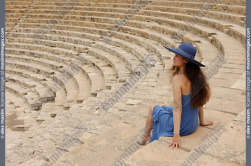 Travel stock photo of an Elegant young woman tourist alone at Greco-Roman Theatre at Kourion Archaeological Site in Cyprus Spring 2007 Horizontal Conceptual artistic photo