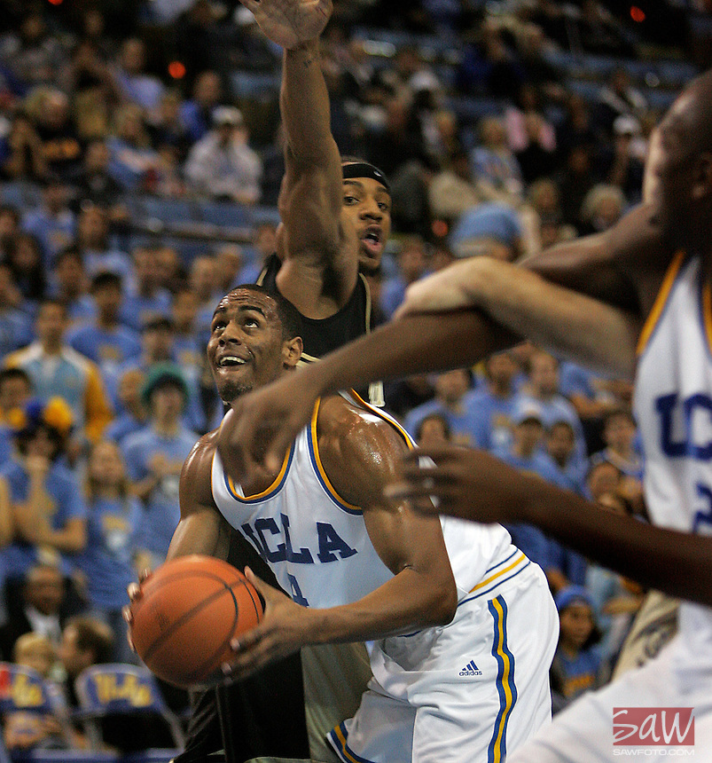 UCLA Bruins Arron Afflalo drives past Oakland Grizzlies Derick Nelson during 1half action NCAA basketball at Pauley Pavilion, December 16, 2006.