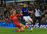 23rd  November 2019; Goodison Park , Liverpool, Merseyside, England; English Premier League Football, Everton versus Norwich City; Lucas Digne of Evertonis tackled by Todd Cantwell of Norwich City - Strictly Editorial Use Only. No use with unauthorized audio, video, data, fixture lists, club/league logos or 'live' services. Online in-match use limited to 120 images, no video emulation. No use in betting, games or single club/league/player publications