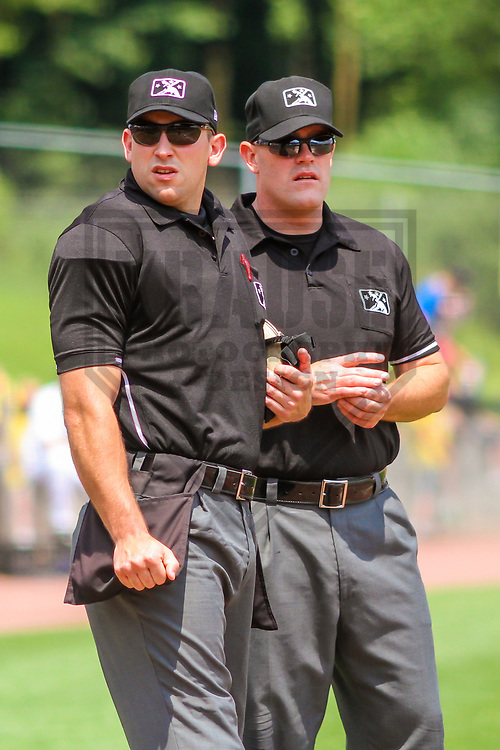Umpires Jason Johnson (left) and James Folske (right) during a Midwest League game between the Wisconsin Timber Rattlers and the Burlington Bees on July 10, 2017 at Fox Cities Stadium in Appleton, Wisconsin.  Burlington defeated Wisconsin 6-3. (Brad Krause/Krause Sports Photography)
