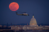 A United States Marine Corps helicopter is seen flying through this scene of the full Moon and the U.S. Capitol on Tuesday, Feb. 7, 2012 from Arlington National Cemetery in Arlington, Virginia. .Mandatory Credit: Bill Ingalls / NASA via CNP