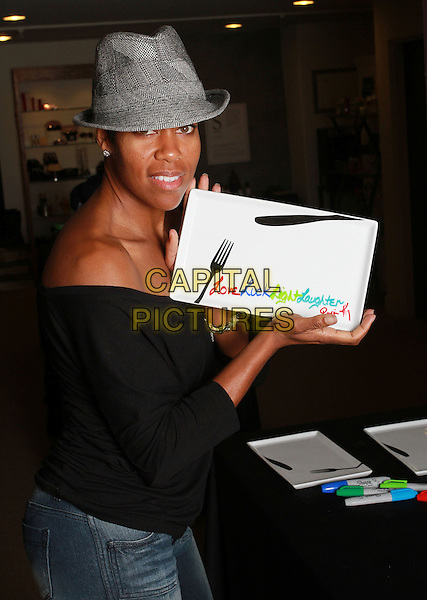 REGINA KING .Visits 2011 Golden Globes Gifitng Services suite On her Birthday held At Gifting Services Showroom, West Westwood, CA, USA, .15th January 2011..half length jeans black off the shoulder grey gray hat fedora side herringbone .CAP/ADM/KB.©Kevan Brooks/AdMedia/Capital Pictures.