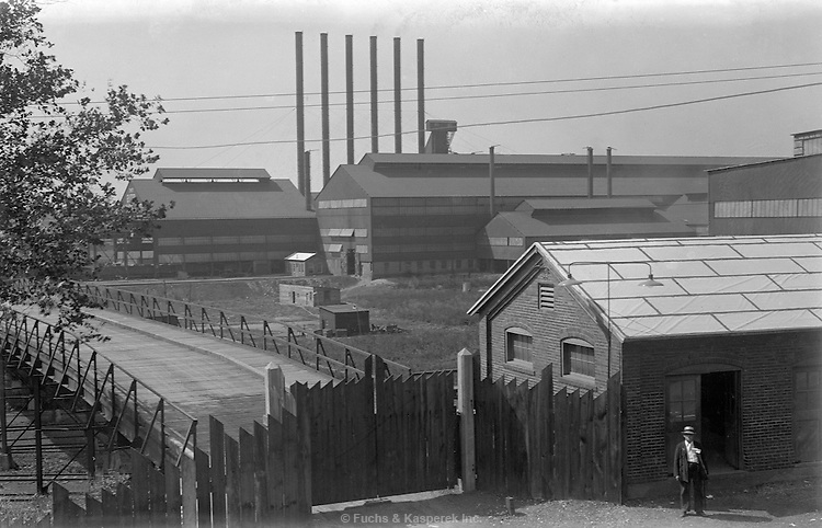 This view shows the front gate of the Otis Steel Mill in Cleveland, Ohio, circa 1915.