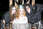 Breda Cremins, Amy Reidy and Rian Gallagher Castleisland on the electric chair at the Knocknagoshel Halloween celebrations on Sunday night..
