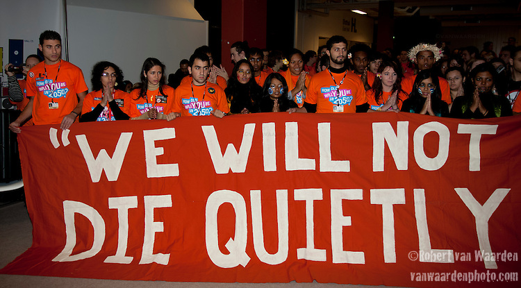 "Members of the International Youth Movement create a storm inside the Bella center using their bodies and stand in solidarity with Africa and vulnerable nations to declare: ""We will not die quietly"".(Images free for Editorial Web usage for Fresh Air Participants during COP 15. Credit: Robert vanWaarden)"