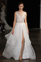 """Model walks runway in an """"XOXO"""" bridal gown from the Rivini by Rita Vinieris Fall 2017 collection on October 7th, 2016 during New York Bridal Fashion Week."""
