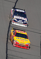 Sept. 28, 2008; Kansas City, KS, USA; Nascar Sprint Cup Series driver Kevin Harvick leads Dale Earnhardt Jr during the Camping World RV 400 at Kansas Speedway. Mandatory Credit: Mark J. Rebilas-