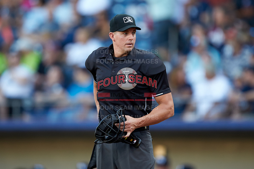 Home plate umpire Shane Livensparger works the International League game between the Scranton/Wilkes-Barre RailRiders and the Gwinnett Stripers at Coolray Field on August 17, 2019 in Lawrenceville, Georgia. The Stripers defeated the RailRiders 8-7 in eleven innings. (Brian Westerholt/Four Seam Images)