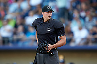 Home plate umpire Shane Livensparger works the International League game between the Scranton/Wilkes-Barre RailRiders and the Gwinnett Stripers at BB&T BallPark on August 17, 2019 in Lawrenceville, Georgia. The Stripers defeated the RailRiders 8-7 in eleven innings. (Brian Westerholt/Four Seam Images)