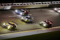 Three-wide traffic in the banking at night, Rolex 24 at Daytona, Daytona International Speedway, Daytona Beach, FL, January 2014.  (Photo by Brian Cleary/www.bcpix.com)