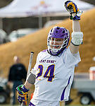 UAlbany Men's Lacrosse defeats Stony Brook on March 31 at Casey Stadium.  Alex Burgmaster (#24) celebrates a score.