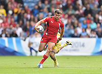 Wales's Luke Morgan runs the ball forward<br /> <br /> Australia Vs Wales - Men's quarter-final<br /> <br /> Photographer Chris Vaughan/CameraSport<br /> <br /> 20th Commonwealth Games - Day 4 - Sunday 27th July 2014 - Rugby Sevens - Ibrox Stadium - Glasgow - UK<br /> <br /> © CameraSport - 43 Linden Ave. Countesthorpe. Leicester. England. LE8 5PG - Tel: +44 (0) 116 277 4147 - admin@camerasport.com - www.camerasport.com