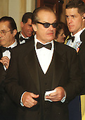 Jack Nicholson waits to be announced to United States President Bill Clinton as he arrives for the White House Millennium Dinner in Washington, D.C. on December 31, 1999..Credit: Ron Sachs / CNP