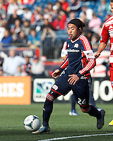 New England Revolution midfielder Lee Nguyen (24) on the attack. .  In a Major League Soccer (MLS) match, FC Dallas (red) defeated the New England Revolution (blue), 1-0, at Gillette Stadium on March 30, 2013.