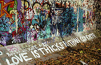 'Love is thicker than concrete' - graffiti, Berlin Wall west zone.10 November 1989