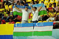 CALI -COLOMBIA-13-09-2016: Hinchas de Uzbekistan animan a su equipo durante el encuentro del grupo A entre Colombia y Uzbekistán de la Copa Mundial de Futsal de la FIFA Colombia 2016 jugado en el Coliseo del Pueblo en Cali, Colombia. / Fans of Uzbekistan cheer for their team during the match of the group A between Colombia and Uzbekistan of the FIFA Futsal World Cup Colombia 2016 played at Metropolitan Coliseo del Pueblo in Cali, Colombia. Photo: VizzorImage/ NR / Cont