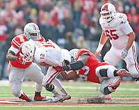 Indiana Hoosiers quarterback Zander Diamont (12) is taken down by Ohio State Buckeyes wide receiver James Clark (82) and Ohio State Buckeyes defensive tackle Michael Bennett (63) in the second half at Ohio Stadium on 22, 2014. (Chris Russell/Dispatch Photo)