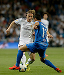 Real Madrid's Croatian midfielder Luka Modric vies with Almeria's Portuguese forward Barbosa during the Spanish league football match Real Madrid Madrid vs U.D Almeria at the Santiago Bernabeu stadium in Madrid on April 12, 2014  PHOTOCALL3000 / DP