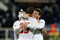 Calcio, Europa League: Andata degli ottavi di finale Fiorentina vs Roma. Firenze, stadio Artemio Franchi, 12 marzo 2015.<br /> Roma's Seydou Keita, left, is hugged by teammate Alessandro Florenzi at the end of the Europa League round of 16 first leg football match between Fiorentina and Roma at Florence's Artemio Franchi stadium, 12 March 2015. The game ended 1-1.<br /> UPDATE IMAGES PRESS/Isabella Bonotto