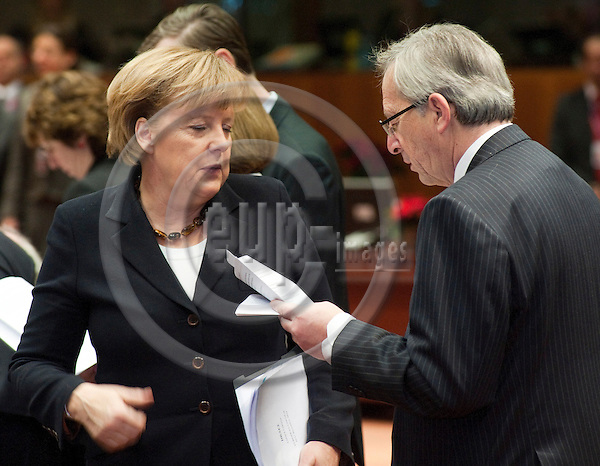 Brussels-Belgium - December 17, 2010 -- European Council, EU-summit under Belgian Presidency; here, Angela MERKEL (le), Federal Chancellor of Germany, with Jean-Claude JUNCKER (ri), Prime Minister (and Ministre d'Etat, Minister for Finance) of Luxembourg -- Photo: Horst Wagner / eup-images