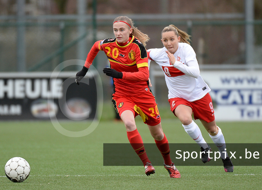 20140208 - OOSTAKKER , BELGIUM : Belgian Julie Biesmans (20) pictured with Polish Patrycja Pozerska (r) during a friendly soccer match between the women teams of Belgium and Poland , Saturday 8 February 2014 in Oostakker. PHOTO DAVID CATRY