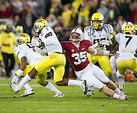 STANFORD, CA - November 7, 2013:  Stanford Cardinal linebacker Jarek Lancaster (35) makes a tackle during the Stanford Cardinal vs the Oregon Ducks at Stanford Stadium in Stanford, CA. Final score Stanford Cardinal 26, Oregon Ducks  20.