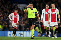 Referee Gianluca Rocchi walks towards the monitor to check whether Chelsea's fifth goal should stand during Chelsea vs AFC Ajax, UEFA Champions League Football at Stamford Bridge on 5th November 2019